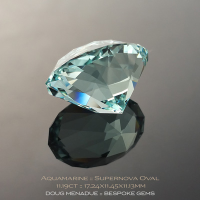 Aquamarine, Supernova Oval, Mozambique, 11.19 Carats, 17.24x11.45x11.13mm, #1063, A very fine natural Aquamarine which has been cut in the wonderful Supernova Oval design. Doug Menadue :: Bespoke Gems :: WWW.BESPOKE-GEMS.COM - Finest Precision Custom Gemcutting Based In Sydney Australia