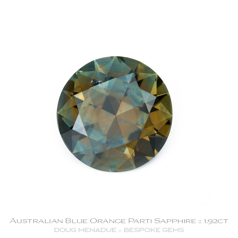 Blue Orange Parti Sapphire, Round Brilliant, Rubyvale, Queensland, Australia, 1.92 Carats, 7.54X7.52X4.74mm, #12112-33, A beautiful natural Blue Orange Parti Sapphire from the Australian sapphire gemfields. Doug Menadue :: Bespoke Gems :: WWW.BESPOKE-GEMS.COM - Finest Precision Custom Gemcutting Based In Sydney Australia