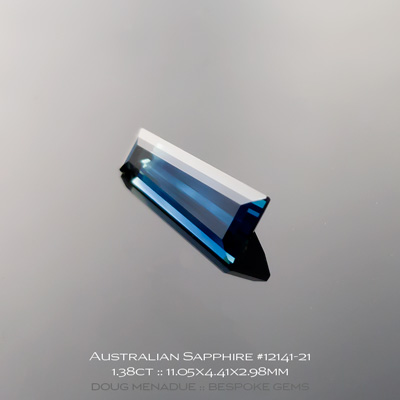 #12141-21, Australian Sapphire, Tapered Baguette, 1.38 Carats, 11.05x4.41x2.98mm, Blue With Light Blue Tip - A beautiful natural Australian Sapphire from the gemfields around Rubyvale, Central Queensland, Australia - Doug Menadue :: Bespoke Gems :: WWW.BESPOKE-GEMS.COM - Finest Quality Precision Custom Gemcutting and Lapidary Services Based In Sydney Australia