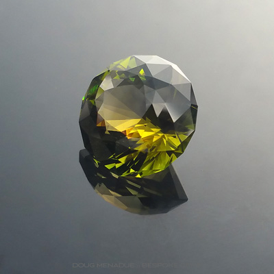 A beautiful large sunset tourmaline that has a wonderful blend of green and harvest gold colours, Precision hand faceted by Doug Menadue :: Bespoke Gems