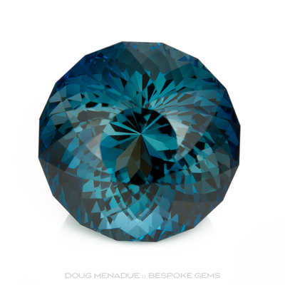 A beautiful large London Blue Topaz with an incedible blue teal colour, Precision hand faceted by Doug Menadue :: Bespoke Gems - Master gemcutter and lapidary artist specialising in fine custom cut precision gems from a wide range of select facet gem rough. Located in Sydney, Australia.