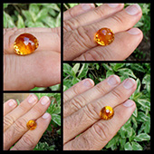 Hand shots of kalli, a 11.5ct flame orange citrine with 185 facets.  In the sunlight this gem is just one big ball of fire... Theres a party going on inside this beauty. - DOUG MENADUE :: BESPOKE GEMS :: Finest Precision Custom Gemcutting Based In Sydney Australia