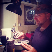 Hard at work cutting gems. Its all an exercise in patience and attention to detail. - DOUG MENADUE :: BESPOKE GEMS :: Finest Precision Custom Gemcutting Based In Sydney Australia