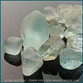 Some of my beautiful natural blue topaz that I hand dug at obriens creek. These natural blues are among my favorite gems to facet. The blue is a soft, delicate and elegant hue, very feminine... think of that lovely blue color that you sometimes see in pictures of icebergs. Think of it like this... natural blue topaz is to sapphires what watercolours are to oils. Both are beautiful and should be appreciated for what they are. Natural blues are scarce and when digging for them, perhaps one in a hundred topaz you find might be a blue. They are a connoisseurs stone, a quiet stone, a cooling calming stone, one that shuns the limelight and is all the more special for it. They have a special place for me,  because I have spent so much time digging for them, so much energy and sweat to find them, elusive, ethereal. When you find your first true blue, well youre hooked for life.  Sounds a bit like love.  - DOUG MENADUE :: BESPOKE GEMS :: Finest Precision Custom Gemcutting Based In Sydney Australia - WWW.BESPOKE-GEMS.COM