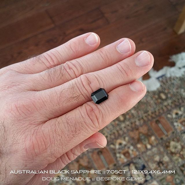 7.05CT Australian ''midnight blue'' black sapphire precision cut in the classic Emerald Cut design. 12.1X9.4X6.4mm. For Sale.  Visit my Whats New page for full details.  DOUG MENADUE  WWW.BESPOKE-GEMS.COM - Precision Gemcutting and Lapidary Services Located In Sydney Australia