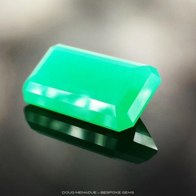 8.9 carats of luscious apple green Marlborough chrysoprase cut in the classic Emerald Cut design.  This gem is translucent and glows.  WWW.BESPOKE-GEMS.COM - Precision Gemcutting and Lapidary Services Located In Sydney Australia