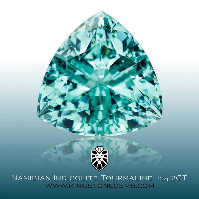 A really fine Namibian paraiba like blue indicolite tourmaline cut in a brilliant trillion design. It is 4.2 carats and 10.41x10.41x6.73mm, a great size for any setting.The colour is amazing and much better then the pic. If you like the pic you will love the gem. A very fine blue indicolite tourmaline.  WWW.KINGSTONEGEMS.COM SYDNEY CBD AUSTRALIA - Precision Gemcutting and Lapidary Services Located In Sydney Australia