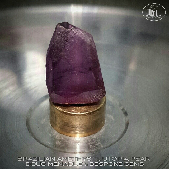 About to start on a nice piece of brazilian amethyst... its going to be a nice big UTOPIA PEAR. I love this rich grape colour,  beautiful.  WWW.BESPOKE-GEMS.COM - Precision Gemcutting and Lapidary Services Located In Sydney Australia