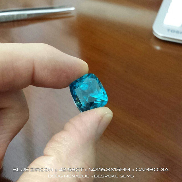 BLUE ZIRCON :: 42.68CT :: 14X16.3X15MM :: CAMBODIA  Here's one from the collection and this it's a monster!  This incredible stone is an exceptionally large Cambodian blue zircon, truly extraordinary, for stones of this size are rare in the extreme especially with this awesome clarity and rich blue colour. This is one for the collector, a big,  beautiful blue zircon, a gem for which you could search a very long time for and not find anything coming even remotely close to it.  This blue zircon is available for sale. Genuine enquires only.  WWW.BESPOKE-GEMS.COM - Precision Gemcutting and Lapidary Services Located In Sydney Australia