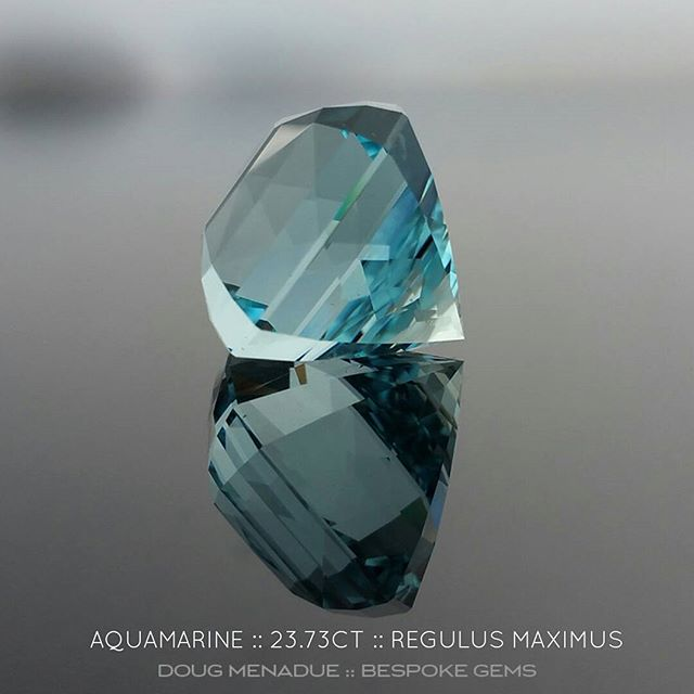 Here is an outstanding aquamarine, the first one to ever be cut in my new design, Regulus Maximus. This beautiful aquamarine gem has a wonderful blue colour and is really something to see. It is 23.73 carats and 16.25x16.22x15.58mm.The design features a high crown and a deep pavilion to really maximise (hence the name) the size, colour and presence of this amazing stone. It is a gem that makes a statement! The design really brings this aquamarine to life and features a very lively, sharp, crisp facet pattern action. This gem would be ideal for a spectacular cocktail ring, especially with the high crown which brings fire to the stone. This is an aquamarine that I highly recommend for those that want and like a really serious statement ring, one with a dazzling gem that commands the entire room and draws every eye. Available.  DOUG MENADUE  WWW.BESPOKE-GEMS.COM  SYDNEY CBD AUSTRALIA - Precision Gemcutting and Lapidary Services Located In Sydney Australia