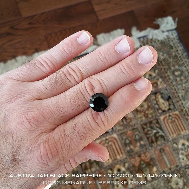 Here's that big beautiful black sapphire from the Australian gemfields of Central Queensland. This is a magnificent gem weighing in at 10.27ct and 14.1x14.1x5.17mm. It has very deep blue flashes of color in its depth. A fine black sapphire.  It is part of an old digger's collection that is now up for sale. Visit my website for full details.  DOUG MENADUE  WWW.BESPOKE-GEMS.COM  SYDNEY CBD AUSTRALIA - Precision Gemcutting and Lapidary Services Located In Sydney Australia