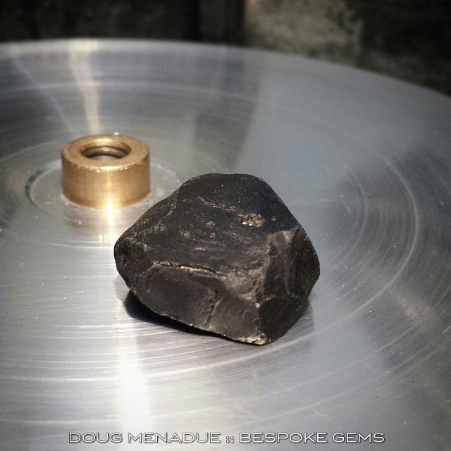 Hi folks,  Hope you're all doing well out there. I've been pretty quiet on the posting front for a while. Back into it for the new year and the first cab off the rank is a nice big black spinel,  66 carats rough.  I'm going to cut a modified Pharoah design which will have a shallower profile then normal. It should look quite something when it's done.  All the best everyone and hope you all have a great new year.  There is a new website coming soon as well... The Bespoke Gems Royale collection will be morphing into something new.  Stay tuned... WWW.BESPOKE-GEMS.COM WWW.BESPOKEGEMSROYALE.COM - Precision Gemcutting and Lapidary Services Located In Sydney Australia