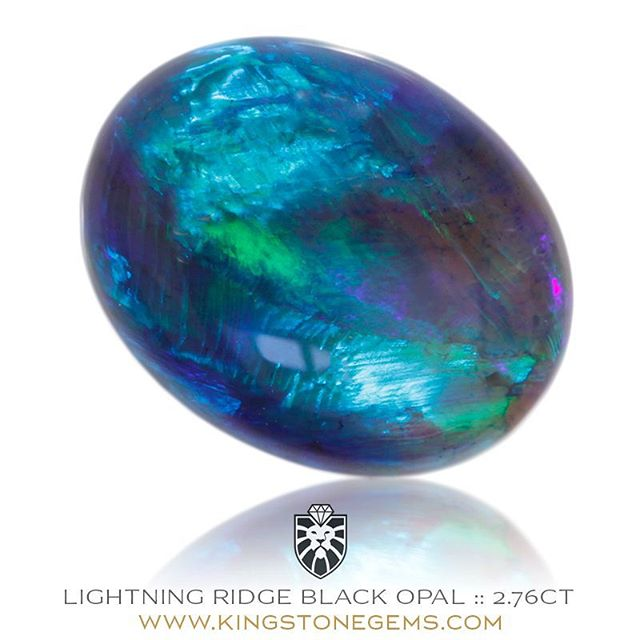 LIGHTNING RIDGE BLACK OPAL - 2.76 CARATS - 11.5X9.08X4.15 MM - One of the many unique and very beautiful opals in our collection, a swirling maelstrom of vivid blues, purples and violets. And don't forget that October's birthstone is opal!  WWW.KINGSTONEGEMS.COM  SYDNEY CBD AUSTRALIA - Precision Gemcutting and Lapidary Services Located In Sydney Australia