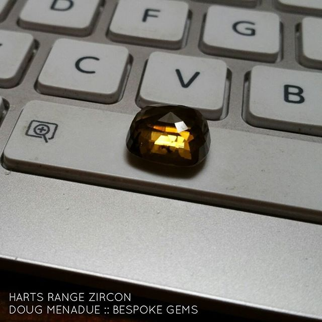 Recut job coming up. This is a large Harts Range zircon and comes from the 'mud-tank' fossicking area. This is a remote region in the Northern Territory,  central Australia where a myriad of gemstones can be found. The zircon is currently a poorly cut and windowed chunky rectangle cushion shape, 13.24x11.84x7.64mm, 15.41ct. Basically I will treat the stone like a good preform. The intention is to recut the zircon in a precision design with correct angles etc. It will be a good size when finished and clarity VVSI to eye clean. This pic was taken early morning in my office and shows a rich brandy caramel sort of color. It will be a special stone and definitely one for the collector as large clean Harts Range zircon are very scarce.  It will be available for sale. Expressions of interest welcome.  DOUG MENADUE  WWW.BESPOKE-GEMS.COM  SYDNEY CBD AUSTRALIA - Precision Gemcutting and Lapidary Services Located In Sydney Australia