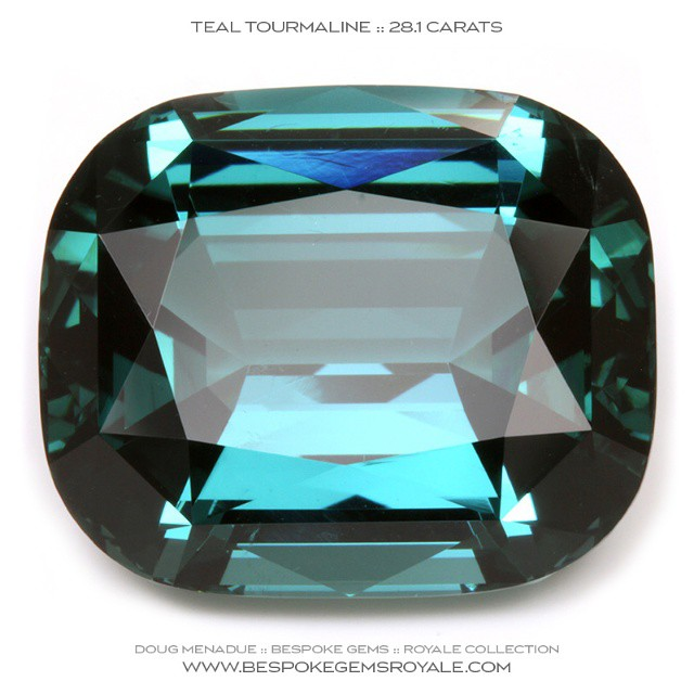 TEAL BLUE TOURMALINE :: 28.1 CARATS :: 19.7x16.6x11.2 MM :: AFGHANISTAN :: CUSHION :: This gem is one of the finest tourmaline of this colour that you could ever hope to see. It is a beautiful gemstone, superb in everyway. It has been precision cut by an Australian gemcutter in a very nice rectangle cushion design so you can be sure the quality of the finish and polish is the very best. It is a large stone and would be the centerpiece of any collection. A unique tourmaline gemstone.  WWW.BESPOKEGEMSROYALE.COM SYDNEY :: AUSTRALIA - Precision Gemcutting and Lapidary Services Located In Sydney Australia