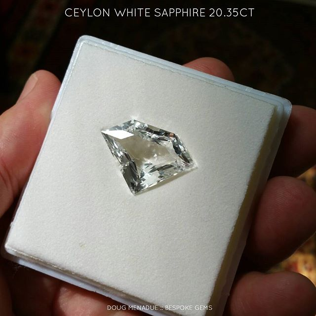 The 'Superman Sapphire'!!! A 20.35ct Ceylon white sapphire that has been precision cut (alas not by me) in a design that looks alot like what superman has on his chest. It's a true collectors stone... I haven't seen a white sapphire this big before. It is available for sale.  DOUG MENADUE  WWW.BESPOKE-GEMS.COM  SYDNEY CBD AUSTRALIA - Precision Gemcutting and Lapidary Services Located In Sydney Australia