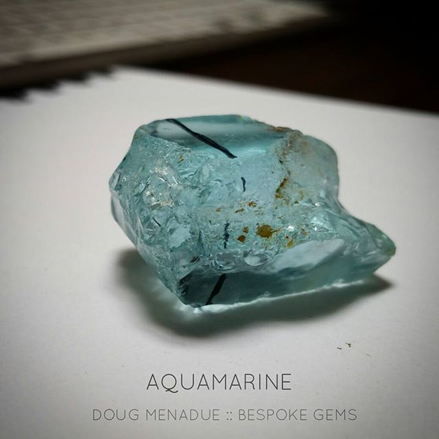 What to do? What to do?  Early stages of planning how to cut this big piece of aquamarine, 106 carats. There is a piece on the end that I'll have to trim away because of flaws. The rest is very juicy. Any suggestions for a design? You've got maybe 15x20mm to play with. This aqua will be one for the store.  DOUG MENADUE  WWW.BESPOKE-GEMS.COM  SYDNEY CBD AUSTRALIA - Precision Gemcutting and Lapidary Services Located In Sydney Australia