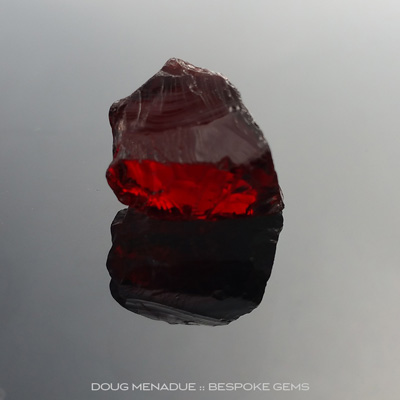 Rose Almandine Garnet, Africa, #r271, A deep ruby red rose almandine garnet. This is a beautiful stone and will cut a stunning gemstone. It will have that deep rich red colour and would suit a round or maybe cushion design. Doug Menadue :: Bespoke Gems
